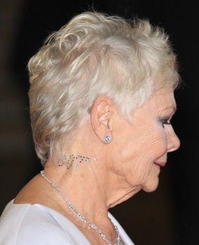 Dame Judi Dench wears a 007 Swarovski crystal tattoo at the Skyfall