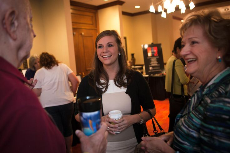 """Glyn Wright, 26, center, talks with Cathie Adams at the """"I Can See"""" conference in downtown, Austin, Texas on Saturday June 21. Wright is the Executive Director of Eagle Forum in Washington, D.C. and leads Eagle Forum's federal lobbying efforts; Adams is the former chair of the Republican Party of Texas."""