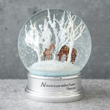 "Horse Whispers Snow Globe  ""Nature is our widest home."" Thoreau's words underscore the beauty of mother and foal wandering through the snowy stillness of wintry woods. Boxed for gift giving. 3-1/2"" Dia. x 5""H."