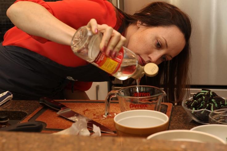 ... Lauren Salkeld measures ingredients for her Mint Hot Fudge Sundaes