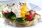 ... egg on sourdough toast, with grilled tomatoes, mushrooms and salad