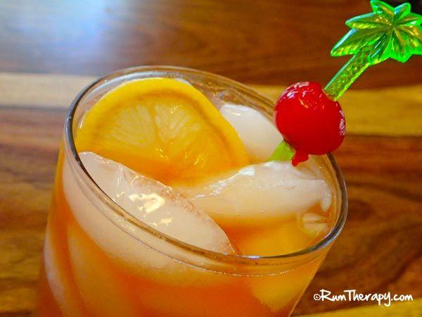 Goombay Smash (2 oz. Dark Rum 1 oz. Coconut Rum 1/2 oz. Apricot Brandy ...