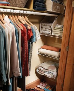 use the corner of the closet by adding shelves.