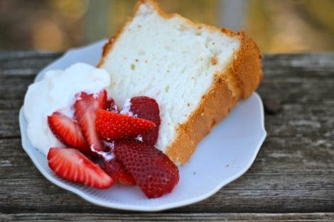 Orange blossom angel food cake with fresh whipped cream & strawberries ...