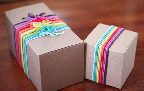 DIY Gift Wrap - Yarn embellishment - Blog - Boutique Window http://www.boutiquewindow.com/blog/articles/diy-gift-wrap/ #DIY #giftwrap #holidays #customers #simple #affordable #crafts #ribbon