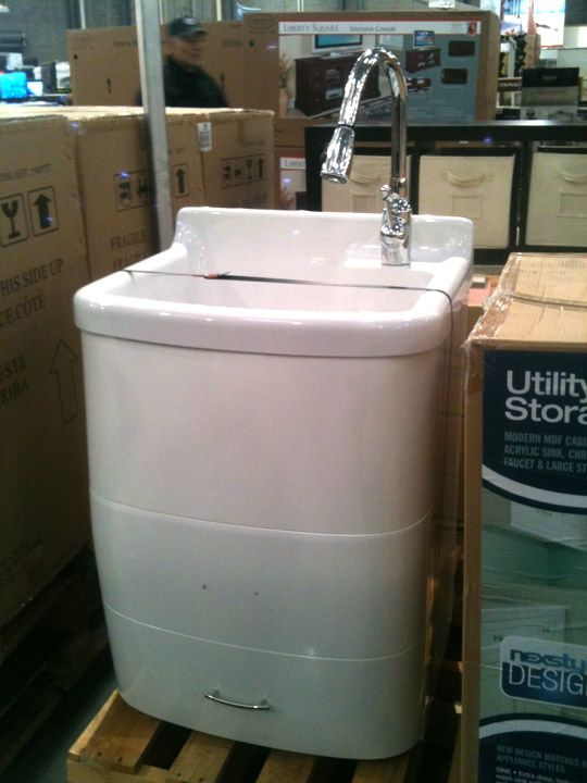 Utility sink with built in storage. Love this for the garage.