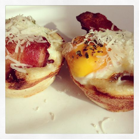 Egg cups - slightly hollowed out muffins with eggs and bacon, topped ...