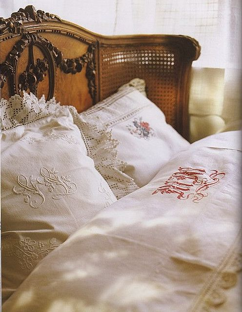 french bed, monogrammed linens