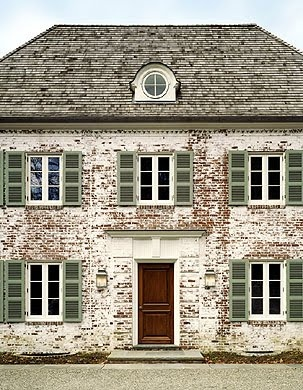 Love the faded blue on the wood beams - White Washed Brick Exteriors Pinterest