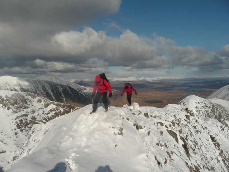 Too busy concentrating to look up for the camera. Teetering along the ridge - a good head for heights needed here. #hiking #snow #winter activities #Scotland #mountaineering
