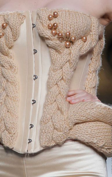 beige knitted wool corset by Maya Hansen: http://knithacker.com/2013/11/20/beige-knitted-wool-corset-by-maya-hansen/ -- from her 2014 Fall/Winter collection. Hat tip: Royce Becker #knithacker