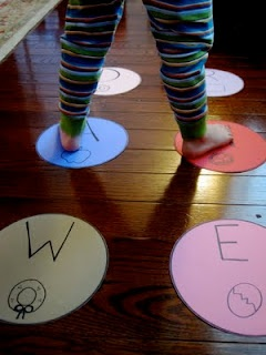 Letters in our name twister. A fun way to move while practicing spelling your child's name. How else could you use twister to learn?