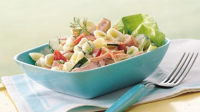 ... pasta salad, with chunks of ham and bright, crunchy vegetables