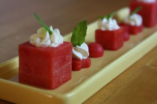 Centers of watermelon shapes are scooped out with a melon baller ...