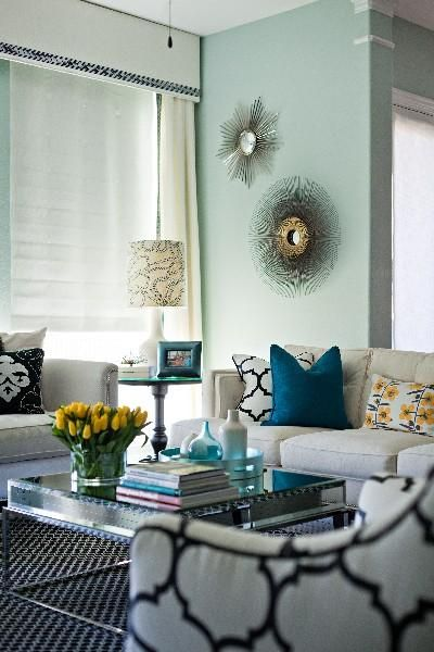 love the print chair, sunburst mirrors, window treatments and rug