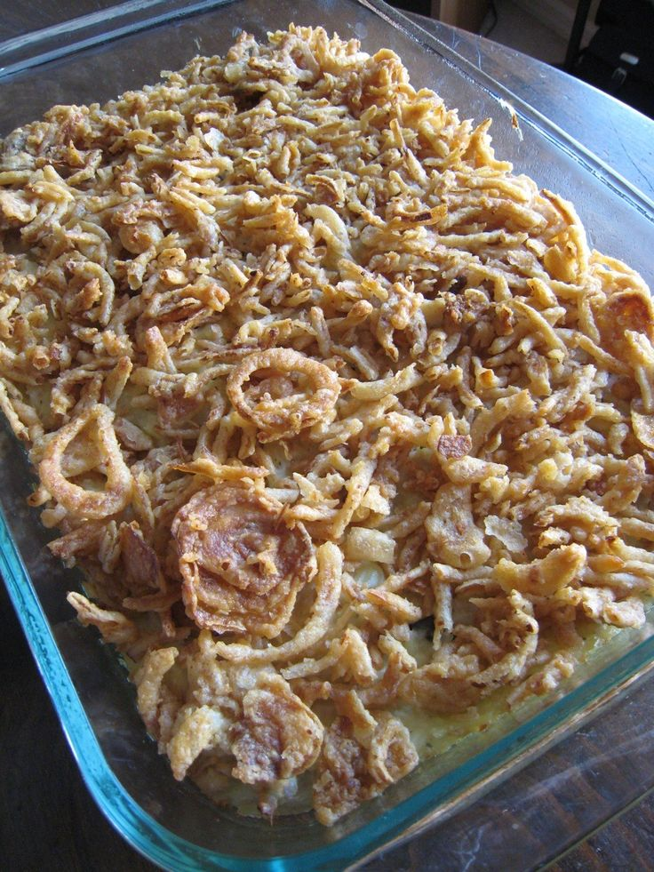 Creamy chicken and rice casserole with French onions on top.