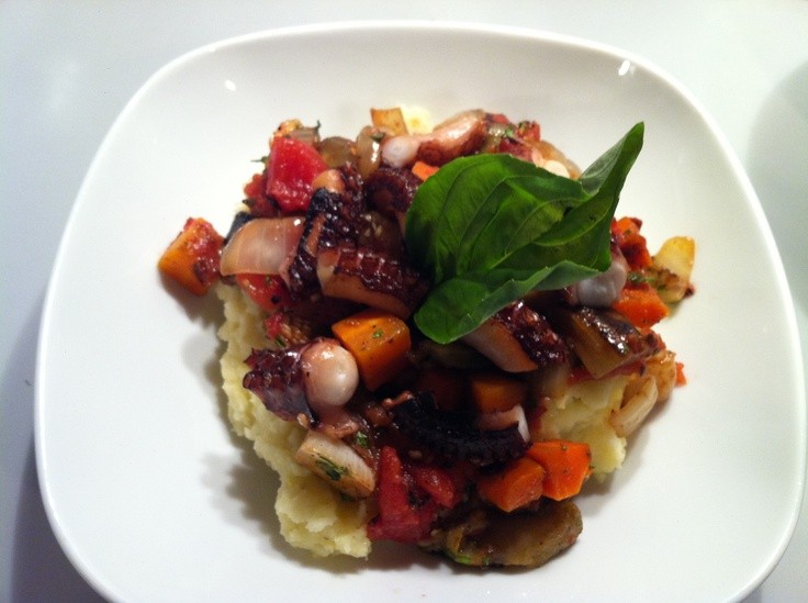 Sautéed octopus with mashed potatoes and ratatouille.