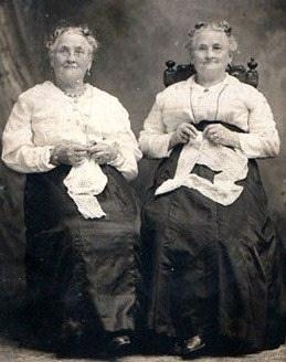 Twins doing handwork, c. 1900