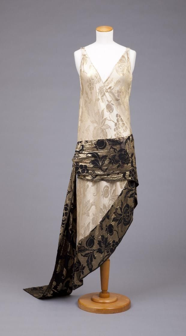 Ivory dress with black and gold sash by Callot Soeurs, French, 1928. The Goldstein Museum of Design.