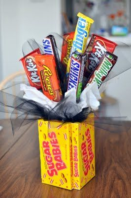 What a fun and simple gift -- I love that they used candy to make the box/container. Add some movie gift certificates and that's an awesome present!