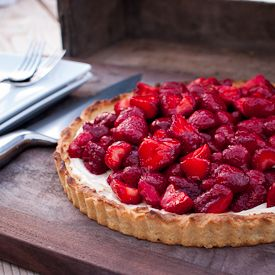 juicy strawberry tart with mascarpone cheese and a port glaze