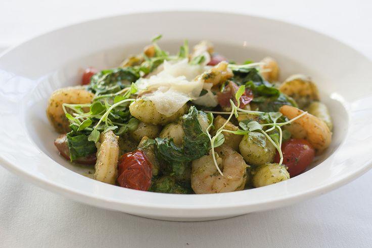 Gnocchi with shrimp, tomato, summer squash, rocket greens, and arugula pesto