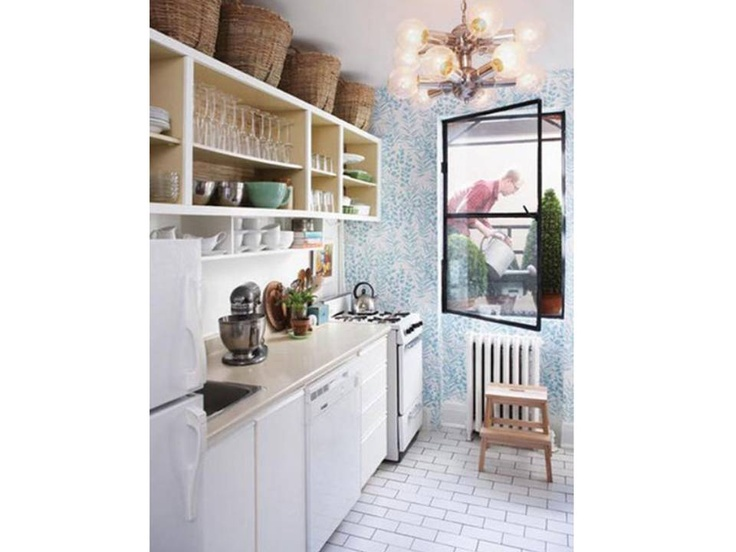 Colors keep this small kitchen light Cream counters, white appliances