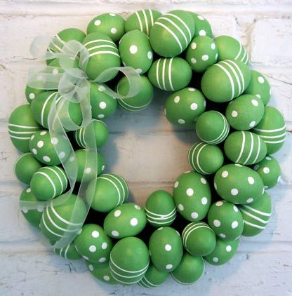 spray paint eggs one color add decorations with white paint and bow too cute