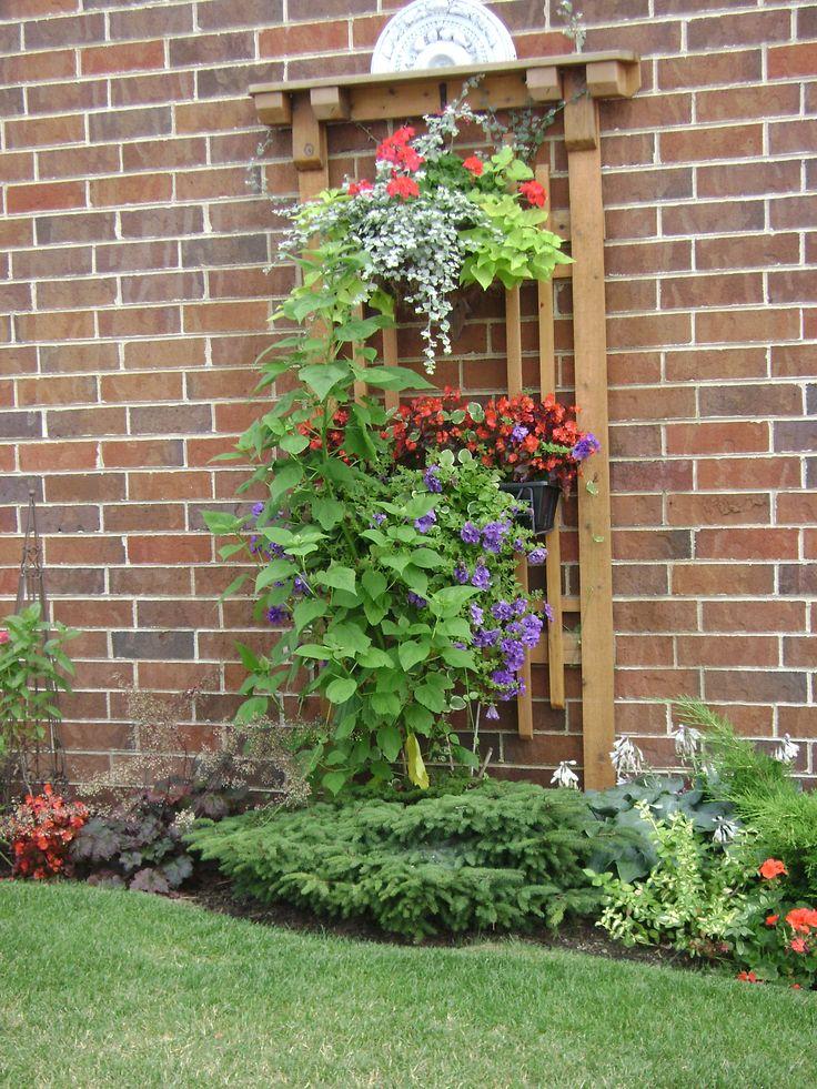 Outdoor wall decor garden pinterest for Outside wall garden