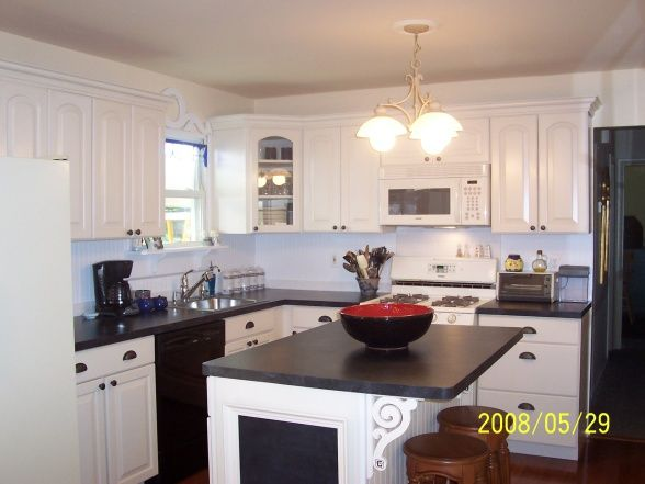 White Kitchen with blue accents, Ivory cabinets compliment our bisque