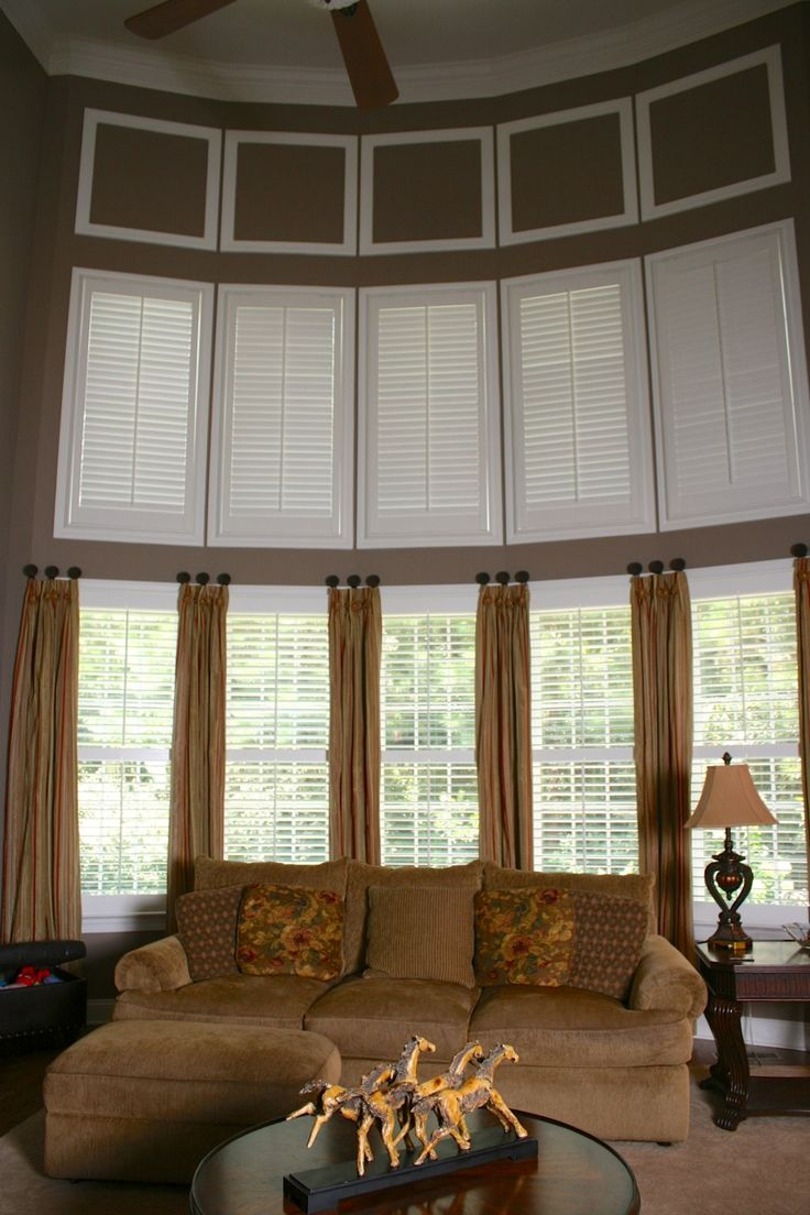 Two story family room plantation shutters on top would be easier to open year round for the for 2 story family room window treatments