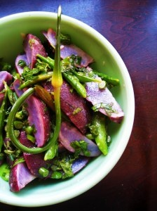 blue potato salad with peas, garlic scapes, daylilies, mint and dill