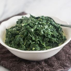 Creamed Spinach: still coated in a rich, cheesy sauce, but lightened ...