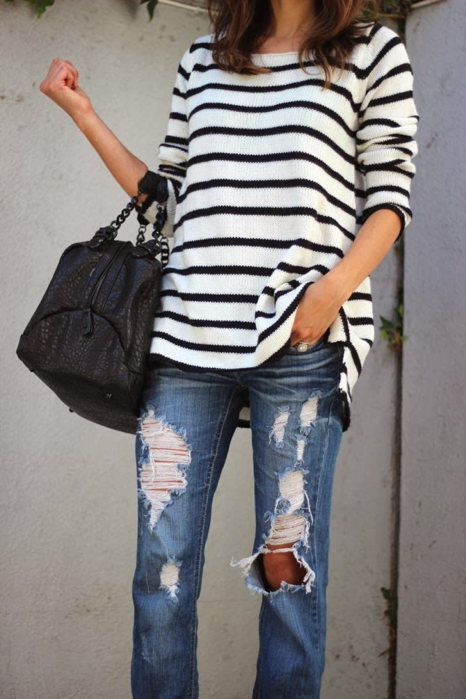 Black and white stripes sweater and blue ripped jeans