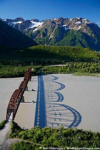 PHOTOS OF MILLION DOLLAR BRIDGE  Aerial view of the Million Dollar Bridge with a perfect shadow on the Copper River  Copper River Delta, Chugach National Forest, Cordova, Alaska