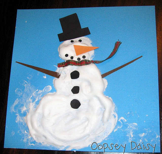 * Mix equal parts of shaving cream and Elmer's glue.  The mixture dries puffy just like this.  * Use your fingers to spread the shaving cream mixture and create your snowmen on blue cardstock.  * Add cardstock pieces to form the eyes, nose, mouth, hat, and arms.  (I used ribbon for the scarf.)  * I saw this adorable idea here at Homemaking Fun.