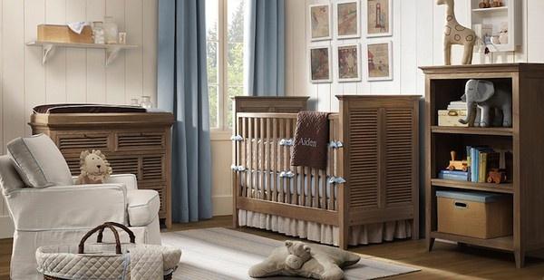 baby nursery in creams and wood tones