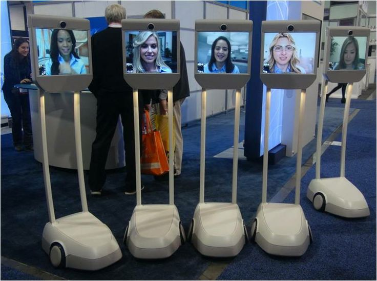 Beam : The Cadillac of Remote Telepresence -  The women in this picture are actually about 600 miles away from the CES 2014 tradeshow floor, at an office in Silicon Valley. yet they can walk and talk with anyone who visited the Beam booth during the show, navigating via a built-in camera and remote controls that move the video display stand around the booth or room.This device, priced at around $20,000, is the leading product in its category.