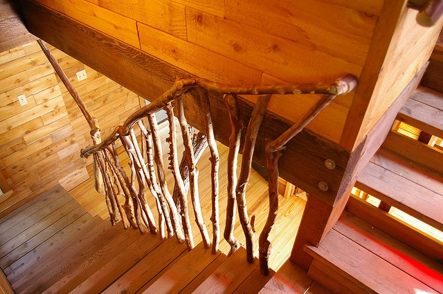 Stair hand-rail made from Bois d'arc tree limbs.  This wood is extremely hard, won't rot and it's impervious to termites.