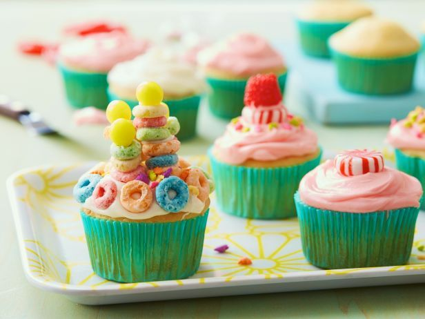 Dye Rachael's classic frosting with your family's favorite colors, then use your imagination to decorate each cupcake with candy or cereal toppings. #RecipeOfTheDay