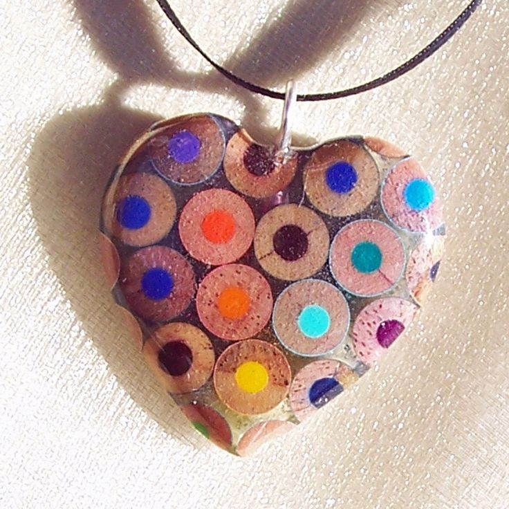 Jennifer Maestre started making jewelry from colored pencils in 2005 by slicing colored pencils at various angles, gluing them together, laminating them, and coating the piece with epoxy. She creates necklace pendants, pins, earrings, and more. Check out her website or shop to see more.