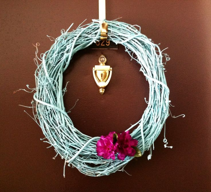 Wreath for door. Just spray painted wreath and tucked in some dollar tree flowers I cut with wire cutters.