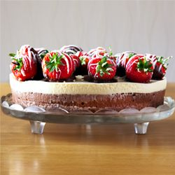 Triple chocolate mousse cake with chocolate covered strawberries