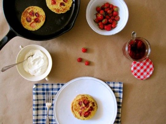pancakes with baby strawberries, strawberry sauce and yogurt