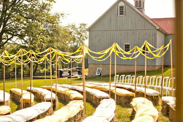 Barn Wedding Ceremony Ideas - blanket covered hay bale guest seating for outdoor ceremony