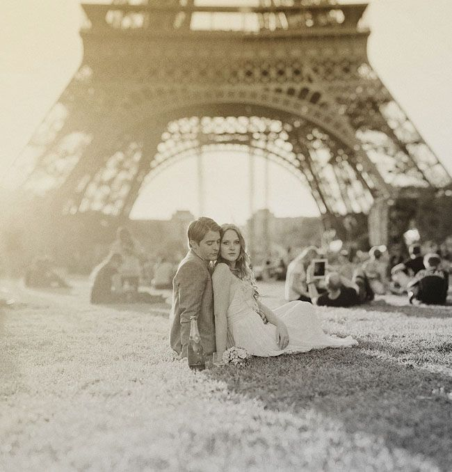 "Honestly, I hate the stereotypical ""romantic Eiffel Tower shot,"" but I love the framing and sense of the couple enjoying themselves on their wedding day."