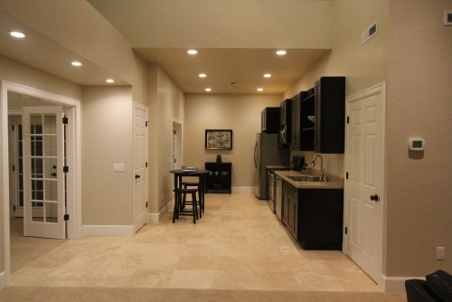 Guest apartment aloha home builders for House plans with inlaw suite in basement