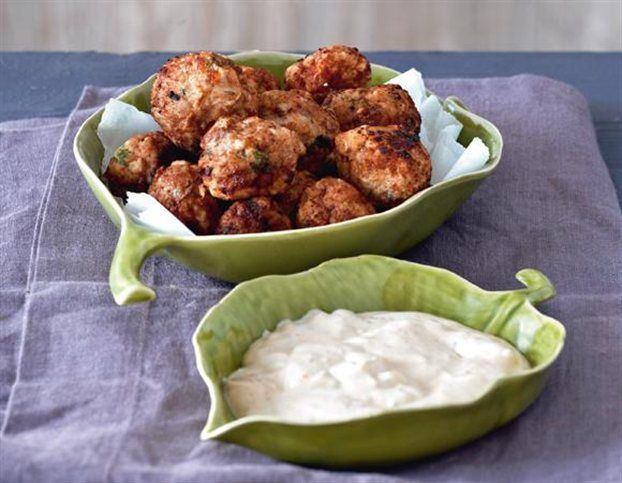 Greek meatballs stuffed with feta cheese and served with a sundried ...