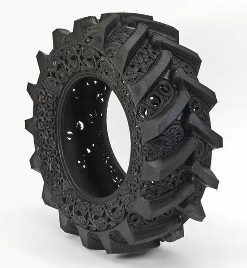 used car tire hand-carved by Belgium artist Wim Delvoye.