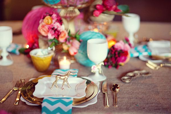 Love all the colors and the chevron napkins, and the tiny little gold horse. SO many details! :)